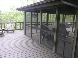 Hedgesville cottage photo - Wrapround deck w screened in porch