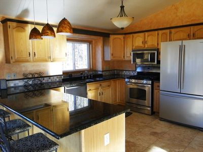 Gorgeous Kitchen with Stainless Steel Appliances and marble counter tops.