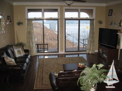 Large open family room with double glass sliders to oceanfront deck!