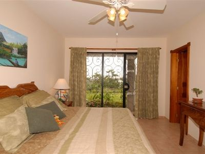 Sweet dreams! Master bedroom enjoys sweeping views over Lake Arenal!