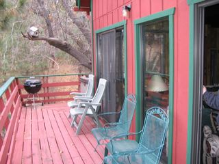 Moonridge cabin photo - Deck for Summer Relaxation looks out on the trees and squirrels