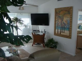 "St. Augustine Beach house photo - Living rm. with tropical paintings, 47"" LCD TV/DVD with full motion."