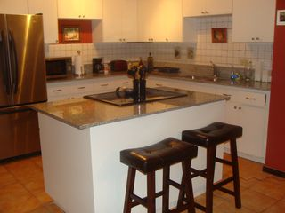 Isabela condo photo - Fully Equipped Kitchen - Granite counter tops & stainless steel appliances