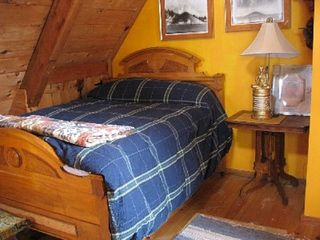 Cooperstown cabin photo - bedroom with down comforter and original photographs