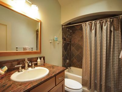 Bright bathroom with relaxing tub/shower. Slate and granite throughout