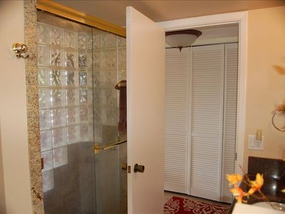 Master Bathroom with glass tiled shower.