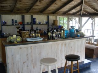 Dennis Village cottage photo - Boathouse bar at lakeside with wrap-around windows.