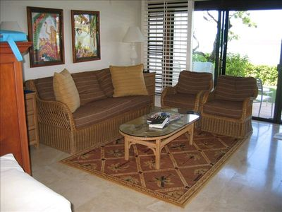 Living Room with pull-out Queen Sofa-Sleeper. Travertine floors and a Bahama rug
