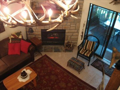 Branson Canyon condo rental - Cozy living room with electric fireplace ...screened sunroom with lake view!