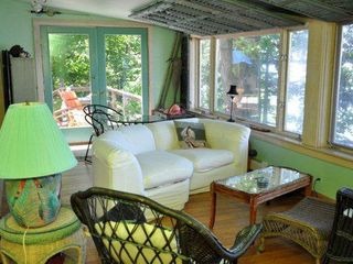 Main house - enclosed porch lakeside of dining-living room area - Canandaigua cottage vacation rental photo