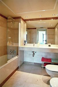 One of the marble bathrooms