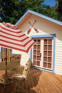 Rear shed holds cushions, beach chairs, umbrella and cooler.