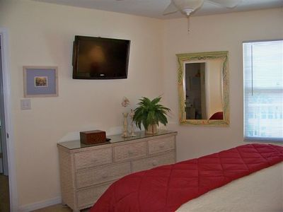 Guest bedroom with wall-mounted 32' HDTV with built-in DVD player