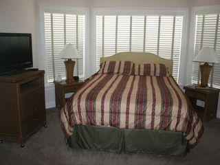 "Flagler Beach house photo - Queen size suite with 42"" HDTV and 250 channels."