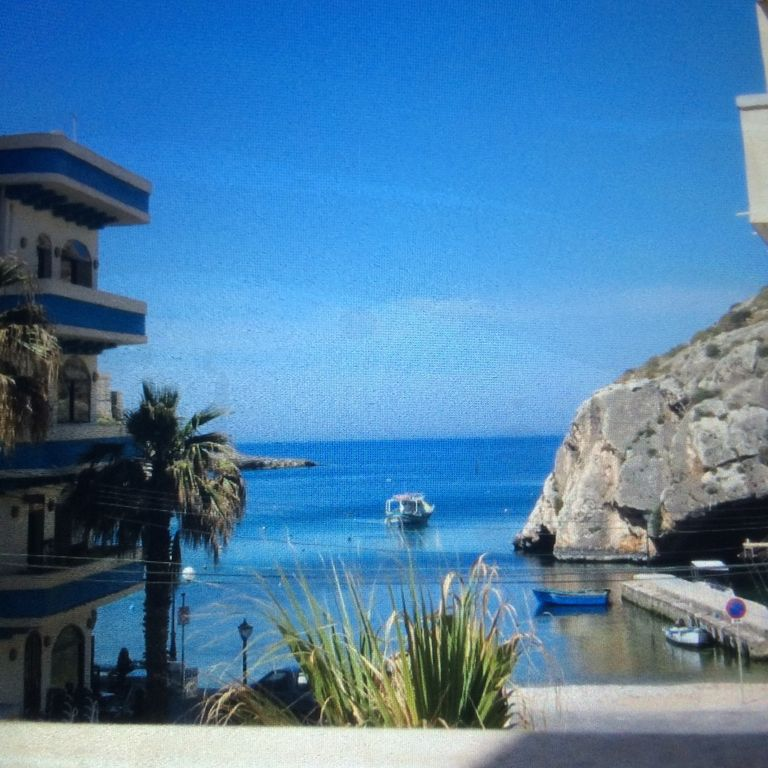 Top apartment in the centre of Xlendi Bay minute away from sandy beach+free wifi