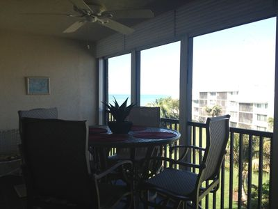 In our high top patio furniture, enjoying our view of the beach and courtyard.