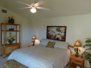 The master suite is located on the upper level and opens to the second lanai.