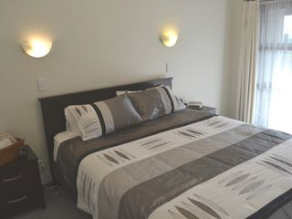 Auckland CBD townhome photo - Master bedroom with brand new king bed and balcony with city views.