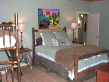 Queen bedroom with 1 set of bunks