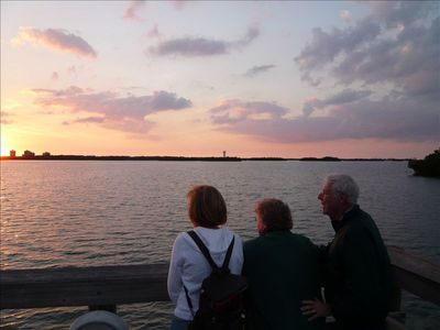 We watch the sun set over Estero bay from the BONITA BAY boardwalk.