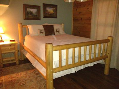 Queen size bedroom on main floor just off kitchen has dresser & large closet.