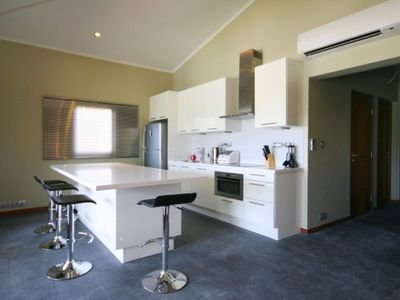 Luxury, modern European kitchen with quality stainless steel appliances
