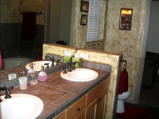 Flagstaff house photo - Master bath, raised sinks, jetted tub and glass shower
