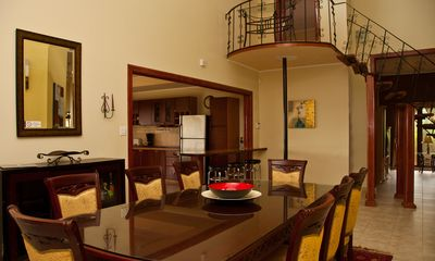 Dining room overlooking the kitchen and staircase to upper master bedroom