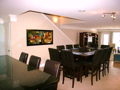 Dining area in PP3. There is seating for 10 at the table and 7 at the bar.