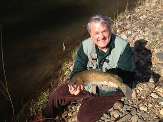 Bakersville cottage photo - Owner with 22 inch trophy rainbow caught in blue ribbon trout stream on site.