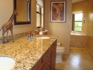 Fort Lauderdale house photo - Master bath with dual sinks, shower and large tub