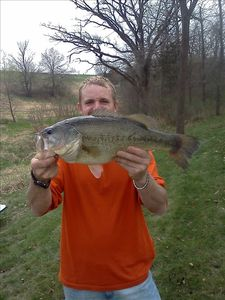 Apple River cabin rental - Our guest landed this huge bass from the pond, 3/24/12,