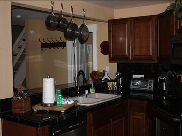 Mammoth Lakes condo rental - New kitchen with granite and dark wood cabinets