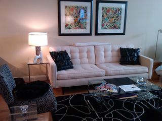 Logan Circle condo photo - Stylish living area features ample seating area (some seating not shown).