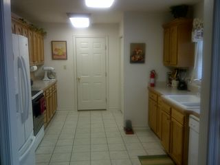 Moneta house photo - Modern kitchen. Garage door visible, Laundry center back right.