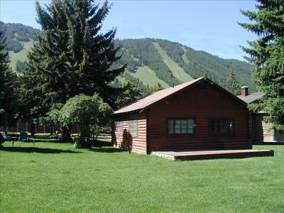 The old historic log cabin is part of the spacious grounds across from Snow King