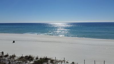 Beach and Gulf view from balcony DIRECTLY on Gulf. Great east and west views!