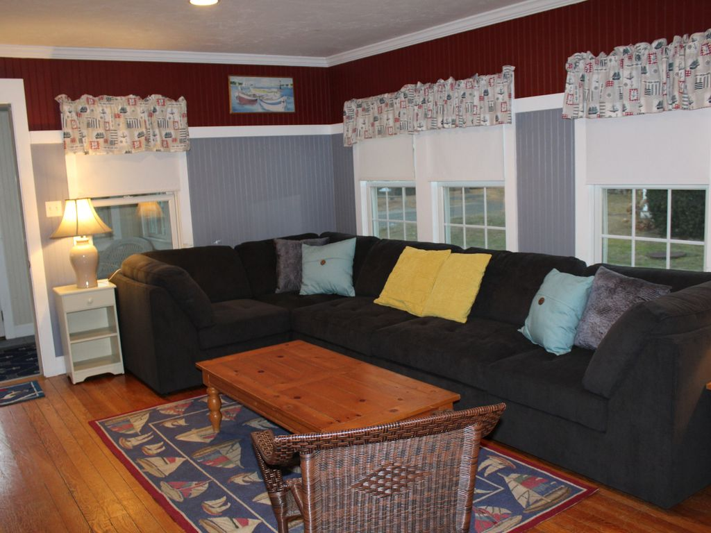 Walk to beach from this six bedroom cape cod vrbo for Lots of seating in small living room