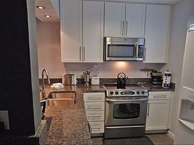 fully renovated kitchen includes all new appliances & granite countertops.