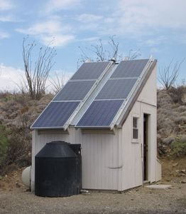 Solar shed with six 200W solar panels and true sine inverter provide electricity
