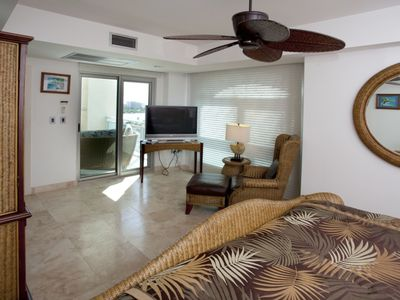 Oceanfront guest bedroom with access to main patio