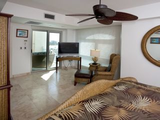 Cupecoy condo photo - Oceanfront guest bedroom with access to main patio