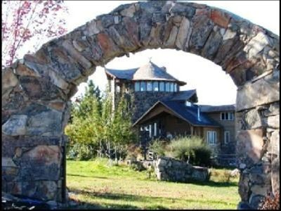 The Stone Tower Main Home View through the Garden Arch