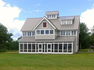 Milbridge house photo - Ocean facing porches and rooftop cupola. 60'X12' screen porch, 20 acre property