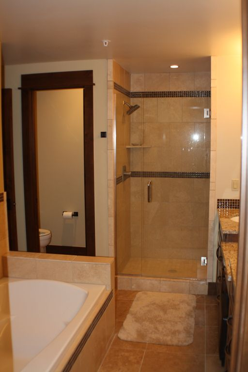 Bathroom with Stone Tile and Euroglass Shower