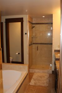 Frisco condo rental - Bathroom with Stone Tile and Euroglass Shower