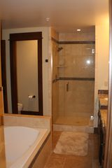 Frisco condo photo - Bathroom with Stone Tile and Euroglass Shower