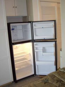 Full regfrigerator with plenty of new wall storage.