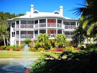 Placida condo photo - .Front view across pond and water fountain