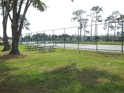 Tennis Courts and picnic area by playground/lake and swings